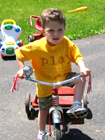 Owen riding his bike at Small Wonders