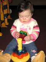 Braelynn playing with her toys